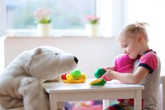 Little girl playing in preschool or at home Stock Photos