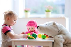 Little girl playing in preschool or at home Stock Images