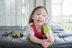 Little girl playing with puppets Stock Photos