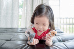 Little girl playing with puppets Royalty Free Stock Photo