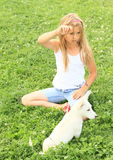 Little girl playing with a puppy Royalty Free Stock Image