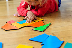 Little girl playing with puzzle, early education. Concept Royalty Free Stock Photos