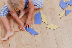 Little girl playing with puzzle, early education. Concept Stock Photo