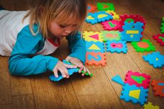 Little girl playing with puzzle, early education. Concept royalty free stock photo