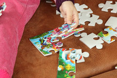 Little Girl Playing With Puzzle Pieces Royalty Free Stock Photos