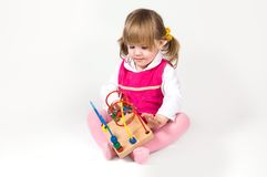 Little girl playing with puzzle toy Royalty Free Stock Photos