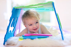 Little girl playing with puzzles Royalty Free Stock Photography
