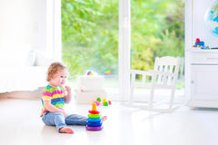 Little girl playing with a pyramid Stock Photos