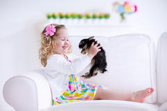 Little girl playing with a rabbit Royalty Free Stock Photo
