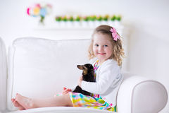 Little girl playing with a rabbit Stock Photo