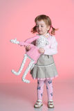 Little girl is playing with rabbit toy Stock Image