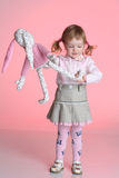 Little girl is playing with rabbit toy Royalty Free Stock Images