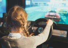 Little girl playing racing simulator. Stock Photography
