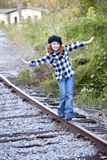 Little girl playing on railroad track royalty free stock images