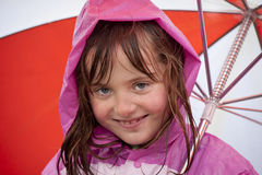 Little girl playing in the rain Royalty Free Stock Photos