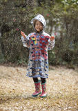 Little girl playing in the rain Royalty Free Stock Photography