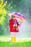 Little girl playing in the rain Stock Photo