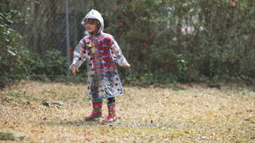 Little girl playing in the rain