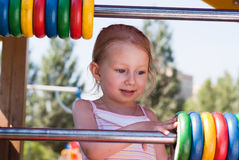 A little girl playing with the rings in the park Royalty Free Stock Photography