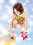 Little girl playing with a round box. Royalty Free Stock Photography