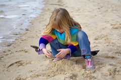 Little girl playing in sand Royalty Free Stock Photography