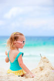 Little girl playing with sand Royalty Free Stock Images