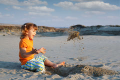 Little girl playing in sand Royalty Free Stock Photos