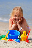 Little girl playing on the sand beach royalty free stock photos
