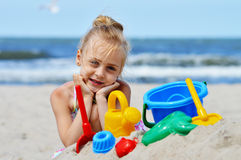 Little girl playing on the sand beach Royalty Free Stock Photo