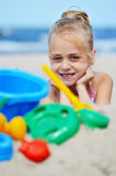 Little girl playing on the sand beach Royalty Free Stock Photography