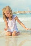Little girl playing with sand. Stock Image