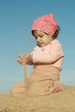 Little girl playing in sand on a beach Royalty Free Stock Photos