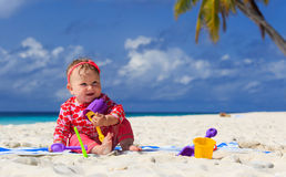 Little girl playing with sand on beach Royalty Free Stock Image