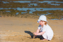 Little girl playing with sand Royalty Free Stock Image