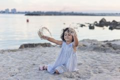 Little Girl playing in the sand at dusk Royalty Free Stock Images