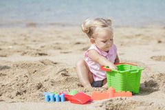 Little girl playing sand toys at the beach Royalty Free Stock Photo