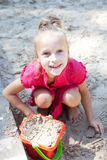 Little girl playing on a sandbox Stock Photos