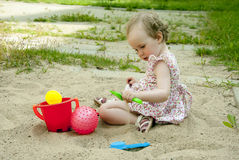 Little girl playing in the sandbox Royalty Free Stock Images