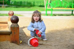 Little girl playing in the sandbox Stock Image