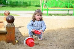 Little girl playing in the sandbox Stock Photo