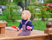 Little girl playing in the sandbox. A Little girl playing in the sandbox Royalty Free Stock Photo