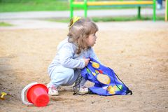 Little girl playing in the sandbox Royalty Free Stock Photos