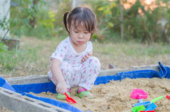 Little girl playing in sandbox Royalty Free Stock Photos