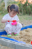 Little girl playing in sandbox Royalty Free Stock Photo