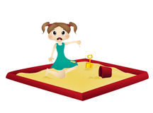 Little girl playing in a sandbox. Full colur Royalty Free Stock Photos