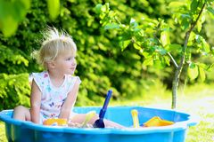 Little girl playing with sandbox in the garden Royalty Free Stock Photography