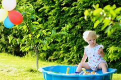 Little girl playing with sandbox in the garden Royalty Free Stock Images