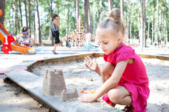 Little girl playing on a sandbox Royalty Free Stock Images