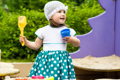 Little girl playing in the sandbox Royalty Free Stock Photography