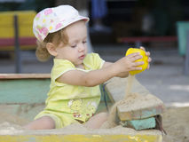Little girl playing in the sandbox Royalty Free Stock Photo